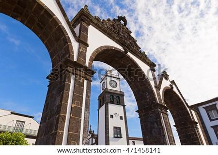 The historical entrance (Portas da Cidade) to the village of Ponta Delgada in Azores, Portugal. Entrance gates and the clock tower of Saint Sabastian church. #471458141