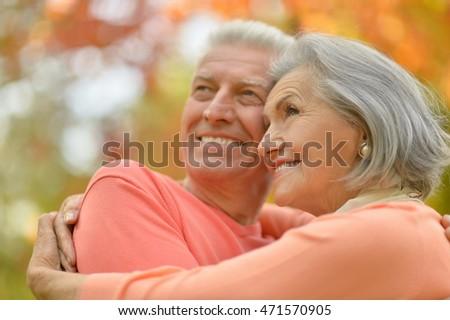 Senior couple in autumn park #471570905