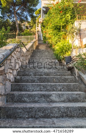 DUBROVNIK, CROATIA - 10TH AUGUST 2016: Steps leading up between streets in the outskirts of Dubrovnik Old Town #471658289