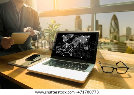IOT hands at work with financial reports and a laptop with other objects around, coffee, top view,business man hand working and internet of things (IoT) word diagram #471780773