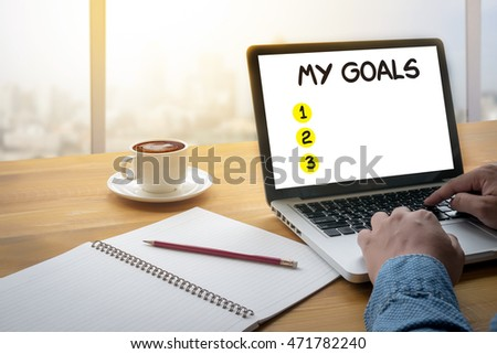 MY GOALS  Handwriting of My Goals  Computing Computer  flare sun, Cropped image male freelancer sitting at the table #471782240