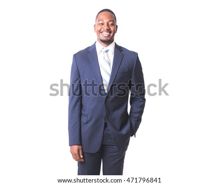 A young man in business attire photographed on a white background.