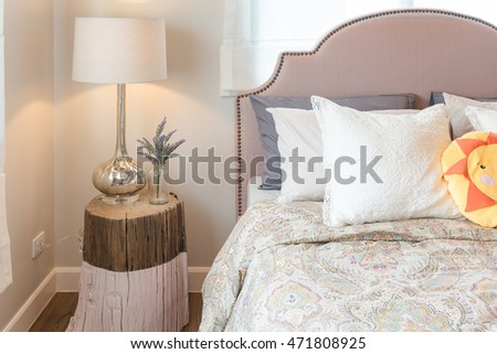 kid's bedroom design with colorful dolls and set of pillows on bed #471808925