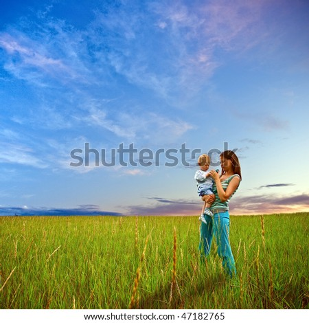 mother and son standing on field #47182765