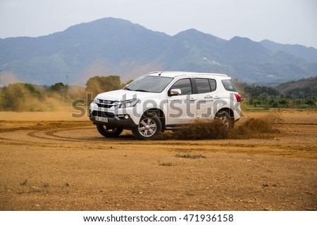 Hanoi, Vietnam - Aug 18, 2016: Isuzu Mu-X all new car running on the test road in the test drive, mountain are in Vietnam. #471936158
