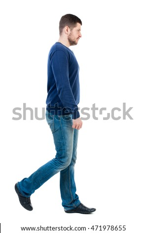 Back view of going  handsome man. walking young guy . Rear view people collection.  backside view of person.  Isolated over white background. bearded man in blue pullover passes by the viewer. #471978655