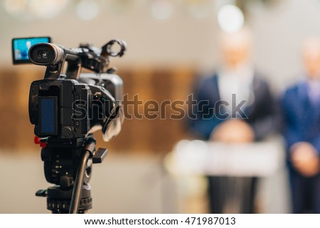 Television camera on  Press Conference