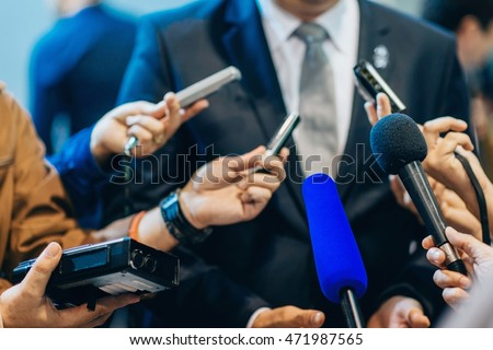Media interview with businessman Royalty-Free Stock Photo #471987565