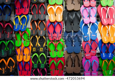 BANGKOK, THAILAND â?? AUGUST, 2016 â?? Colorful slippers are displayed on trellises for sale in Jatujak weekend market. Jatujak market is the largest flea market in the world located in Bangkok, Thailand. #472053694