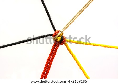 Connected group concept as many different ropes tied and linked together as an unbreakable chain as a community trust and faith metaphor #472109185