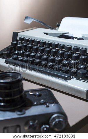 an old typewriter with the camera on the table #472183831