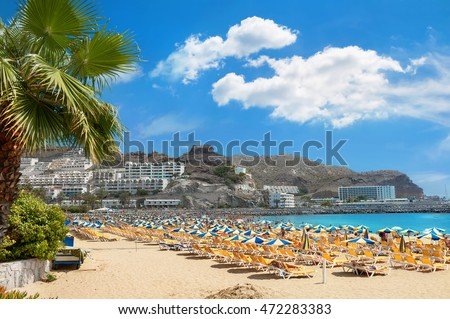 Beach in resort town Puerto Rico. Gran Canaria. Canary Islands Royalty-Free Stock Photo #472283383