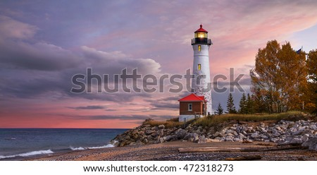 As daylight begins yielding to twilight, The Crisp Point Lighthouse at sunset on Lake Superior, Upper Peninsula, Michigan, USA - A one hour drive from Tahquamenon Falls, mostly dirt roads #472318273