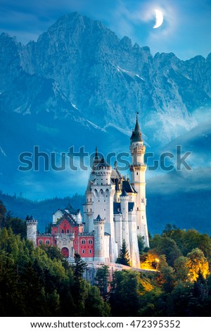 Original view of world-famous Neuschwanstein Castle at night with moon and fog, Germany, European landmark #472395352