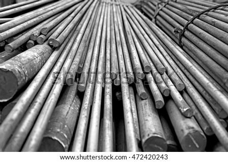 Rust steel bar bunch in warehouse   #472420243