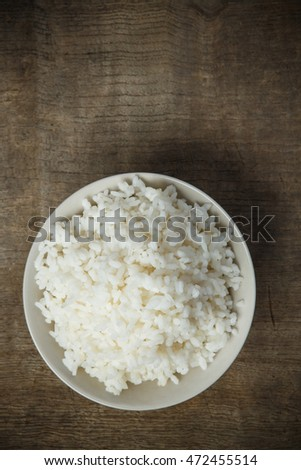 Cooked rice isolated on wooden background #472455514