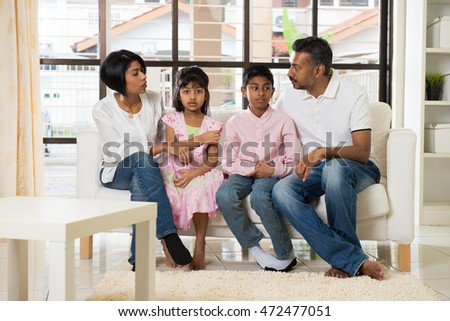 happy indian family at living room #472477051