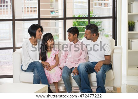happy indian family at living room #472477222