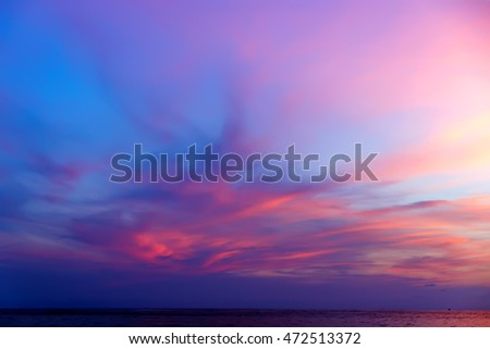 Tropical colorful dramatic sunset with cloudy sky . Evening calm on the Gulf of Thailand. Bright afterglow. #472513372