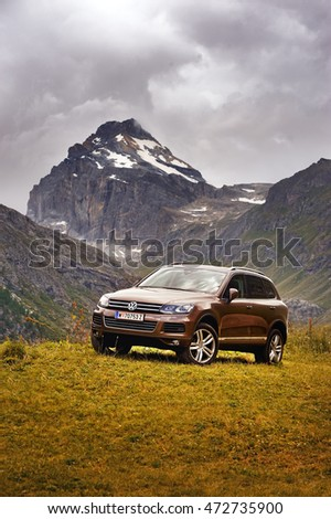 Rhemes Notre Dame, Valle d'Aosta, Italy - July 25, 2016: Volkswagen Touareg ?? in alps with background view of Granta Parey mountain. Photo captured in the alpine mountains. #472735900