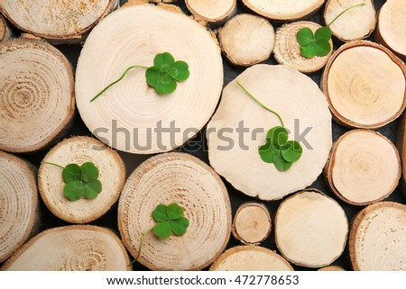 Green four-leaf clovers on wooden background #472778653