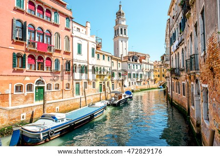 Small romantic water canal with Saint Antonin church in Castello region in Venice #472829176