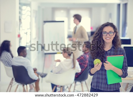 business, startup and people concept - happy creative team with computer and folder in office #472882429