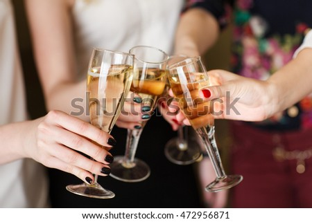 Hands holding the glasses of champagne making a toast #472956871