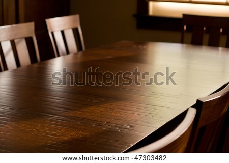 Quartersawn white oak table with distressed finish, surrounded by chairs, in front of window. #47303482