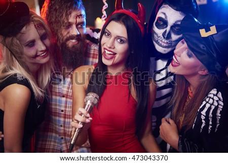 Singing karaoke at halloween party  #473043370