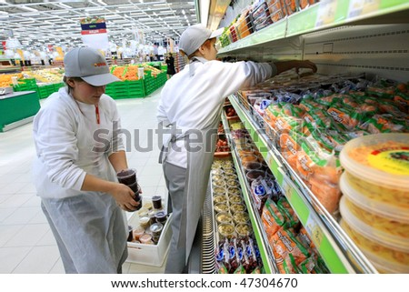 KYIV, UKRAINE - NOVEMBER 13: Worker in supermarket during preparation for the opening of the first store of OK supermarket network on November 13, 2007 in Kyiv, Ukraine. #47304670