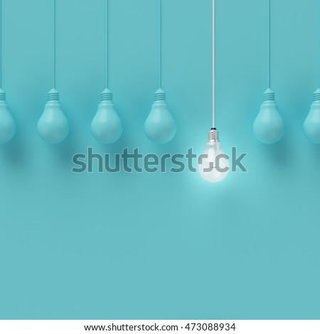 Hanging light bulbs with glowing one different idea on light blue background , Minimal concept idea , flat lay , top Royalty-Free Stock Photo #473088934
