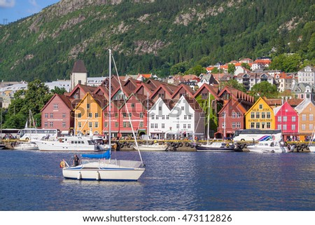 Bergen,Norway - July 20, 2016 : View of Bryggen, a series of Hanseatic commercial buildings lining the eastern side of the fjord coming into Bergen, Norway #473112826