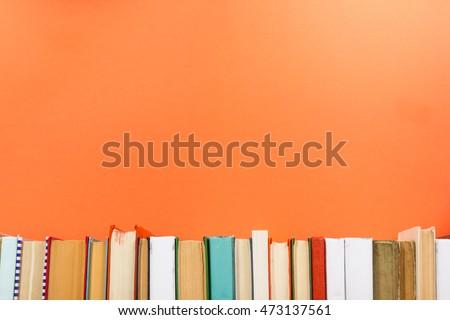 Books on grunge wooden table desk shelf in library. Back to school background with copy space for your ad text. Old hardback no labels, blank spine #473137561