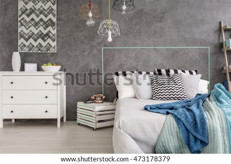 Stylish bedroom with white furniture and decorative wall plaster #473178379