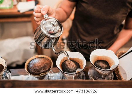 Drip brewing, filtered coffee, or pour-over is a method which involves pouring water over roasted, ground coffee beans contained in a filter. #473186926