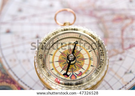 Gold modern compass and old map #47326528