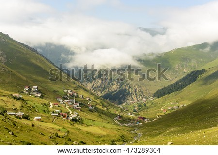 beautiful nature on mountains, there is plateau life under the huge fog #473289304