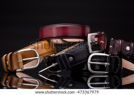 Stack of leather belts Royalty-Free Stock Photo #473367979