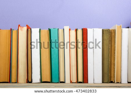 Books on grunge wooden table desk shelf in library. Back to school background with copy space for your ad text. Old hardback   no labels, blank spine #473402833