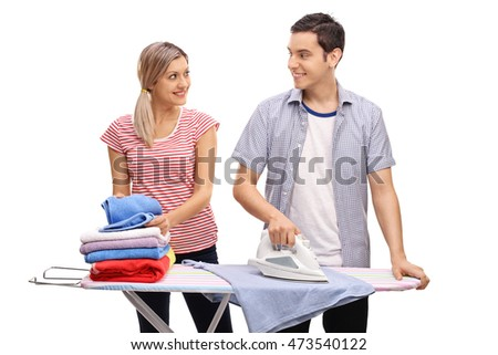 Young couple ironing together isolated on white background