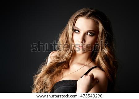 Beautiful sexy girl with dark makeup and long wavy hair. #473543290