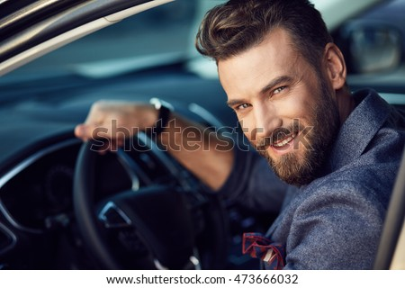 Attractive elegant happy man in good car #473666032