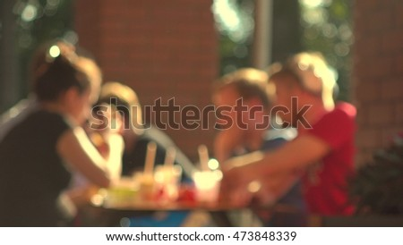 Blurred young people eating fast food outdoor #473848339