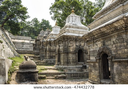 Votive temples and shrines in a row at Pashupatinath Temple, Kathmandu, Nepal #474432778