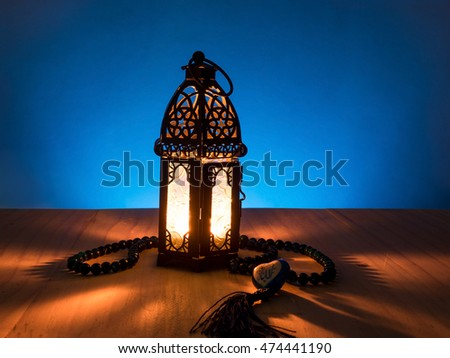 """candle light on muslim style's lantern shining on arabic letter of the name of God """" Allah"""" in heart shape #474441190"""