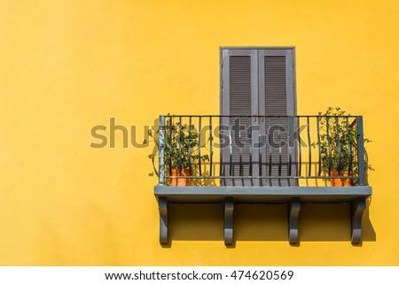 Balconies and the walls orange. #474620569