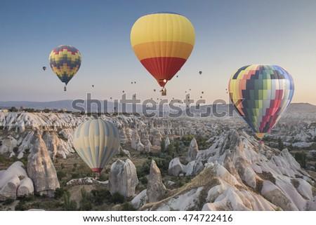 Hot air balloons flying over spectacular Cappadocia #474722416