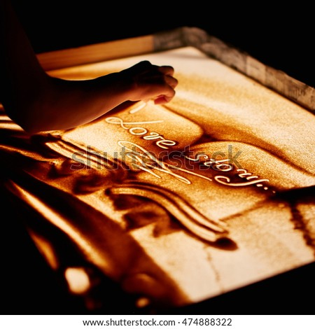 Love story, hand draws on the sand. Sand animation.
