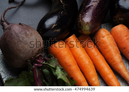 Fresh vegetables are laid out on the kitchen plank on the table. #474994639